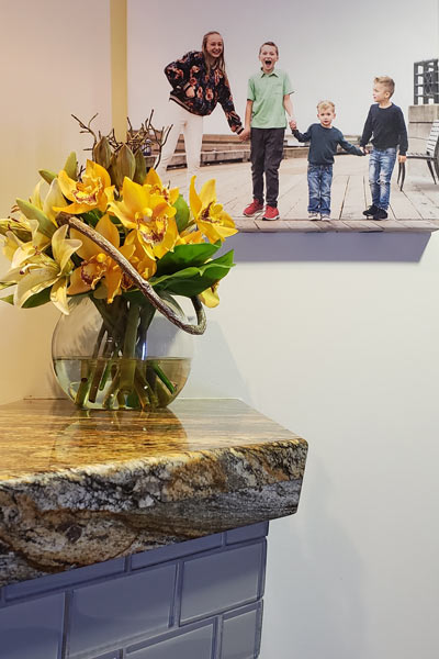 Flowers on the front desk and photo of children on the wall from Cooley Smiles in Bellevue, WA
